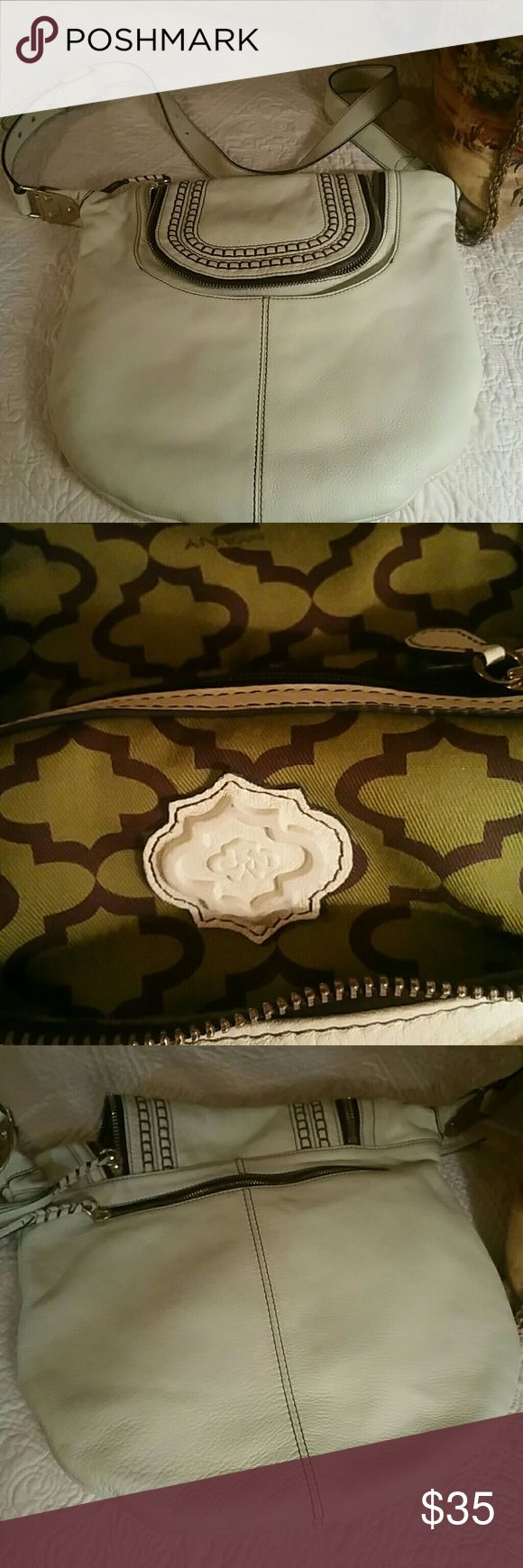 Oryany handbags in Cream with dark brown stitching Cream leather crossbody.  Perfect for summer.  Small scratch less than 1/4 of an inch on front.  Check out my pics.   Cannot even see it!  This bag came from the Neiman Marcus Outlet! oryany Bags Crossbody Bags