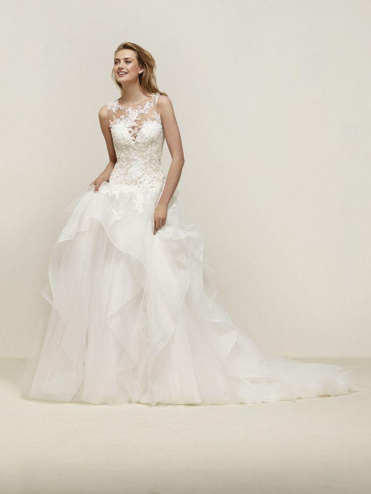 Drapin: Per principesse moderne. Abito da sposa con vaporosi volant a cascata e sensuale corpetto effetto nudo - Pronovias