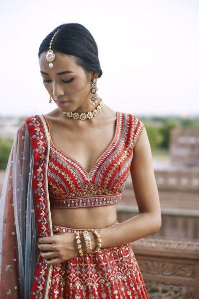 Bridal Lehenga - Red and Powder Blue Lehenga with Gold and Silver Embroidery | WedMeGood  #wedmegood #indianbride #indianwedding #bridallehenga #lehenga #red #blue #bridalportrait #choker