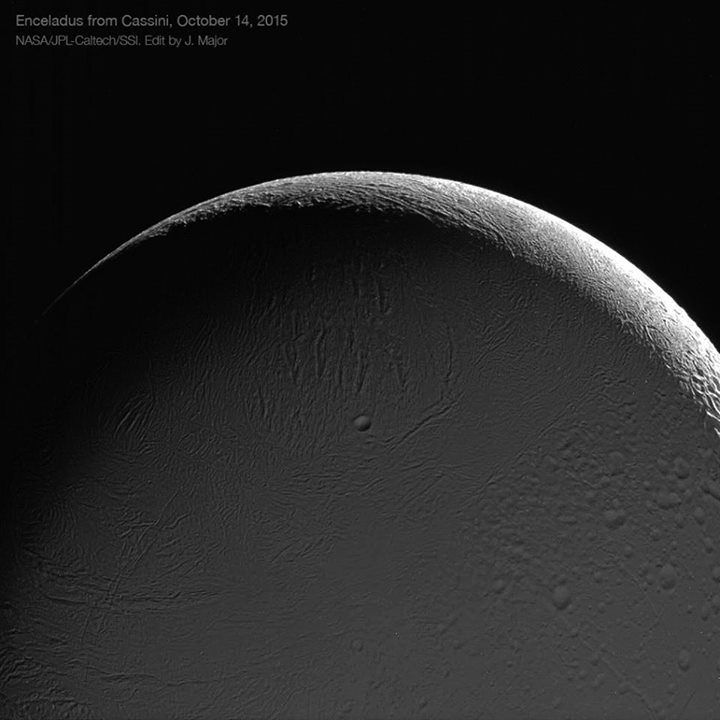 A beautiful view of the night side of a crescent Enceladus, lovingly lit by Saturnshine. This was captured by the Cassini spacecraft during a close pass on Oct. 14, 2015. The 6.5-mile-wide Bahman cater is visible near the center. Credit: NASA/JPL-Caltech/Space Science Institute, image editing by Jason Major.