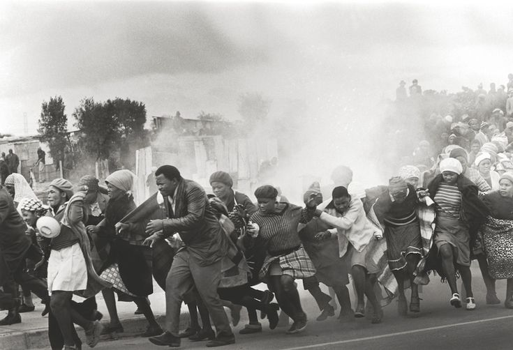 World Press Association Photo of the Year 1977 - Police throw tear-gas at a group of chanting residents of the Modderdam squatter camp protesting against the demolition of their homes outside Cape Town. (Leslie Hammond)