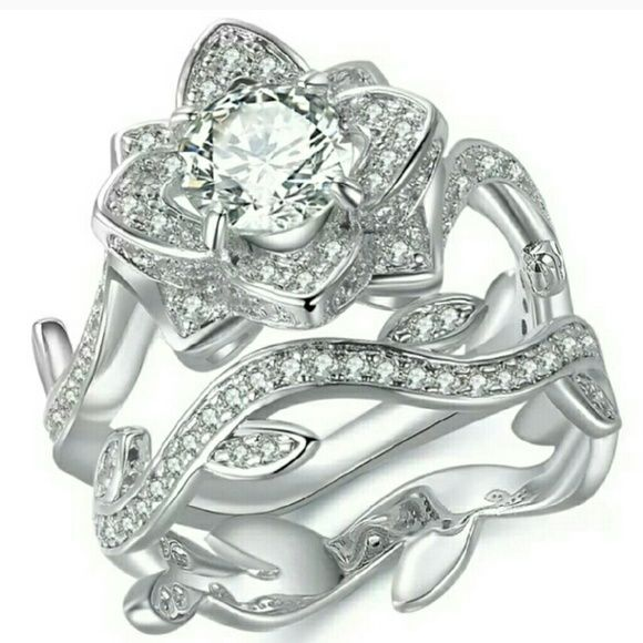 NWT Flower 925 Cz Wedding Set Size 7 An elegant and beautiful set with 1 karat center stone, surrounded by 134 cz's.  Simply gorgeous and stunningly breathtaking. Perfect for anyone.  Wear them together or separate. Stamped 925. Jewelry Rings