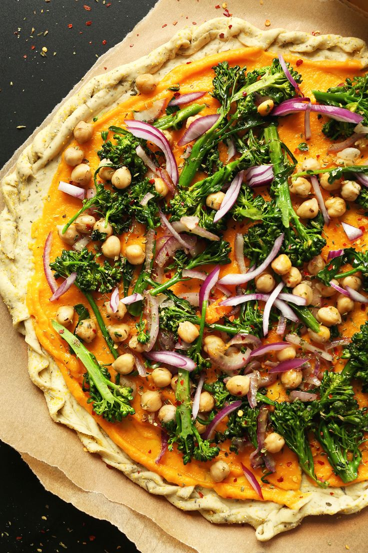 10-ingredient Veggie Pizza with a creamy, savory-sweet butternut squash sauce, chickpeas, and veggies.
