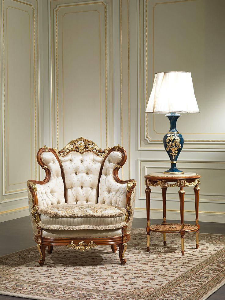 Armchair 800 in classic luxury style of the handcrafted Italian collection Living room of the Nineteenth century. The armhair 800 is distinguished first and foremost for its concave shape, which shape is elegantly highlighted by a frame in wood that draws the contours. All the wooden elements, and in particular the cyma golden, are embellished by carvings executed by hand by Italian expert craftsmen. Also to note is the richness of the finishing pad which helps to make the armchair 800 a…