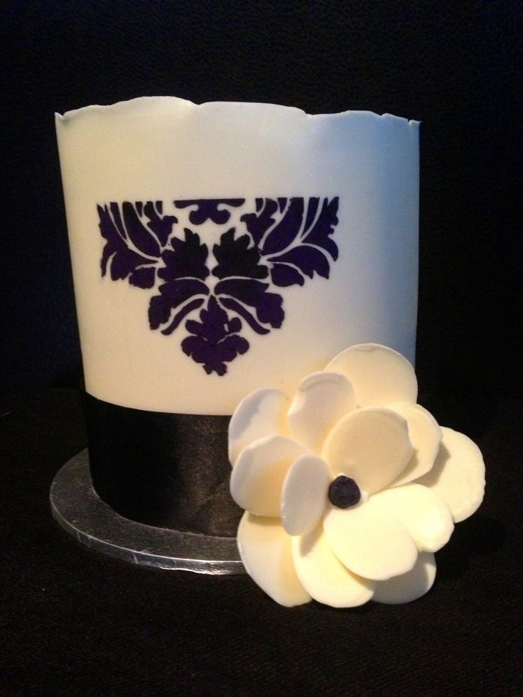 Chocolate collar & chocolate stencilled, with a chocolate 3D flower. A nice wedding or engagement cake.
