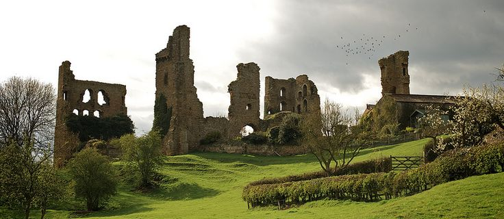 Sheriff Hutton Castle. Sheriff Hutton Castle is a 14th century stone quadrangular fortress, founded by Lord John Nevill, of Raby. In 1382, King Richard II granted John a licence to enclose with a wall of stone and lime and crenellate, a plot in his own ground.