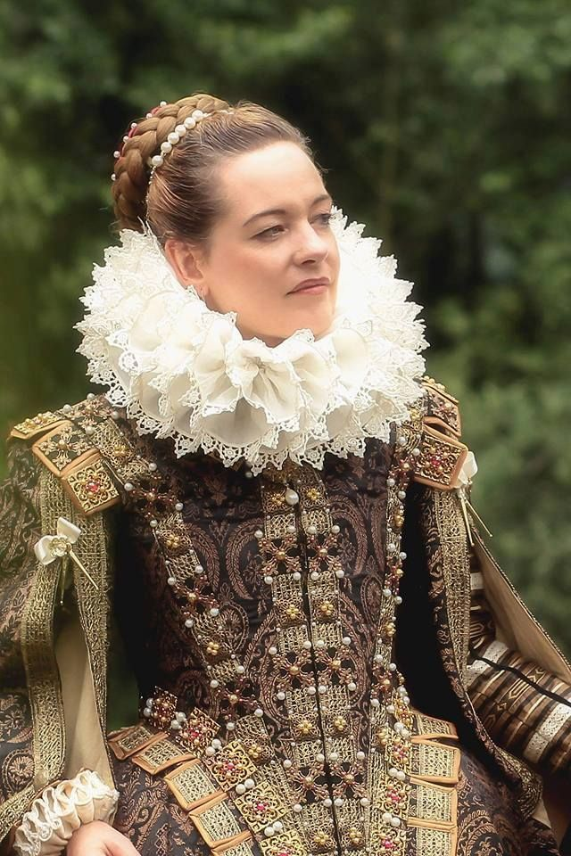 This appears to be a very good replica of Elizabethan dress. Give her a French hood and she's all set! I'm so glad we do not dress like this nowadays.