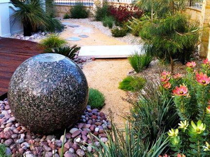 Native garden with ball fountain