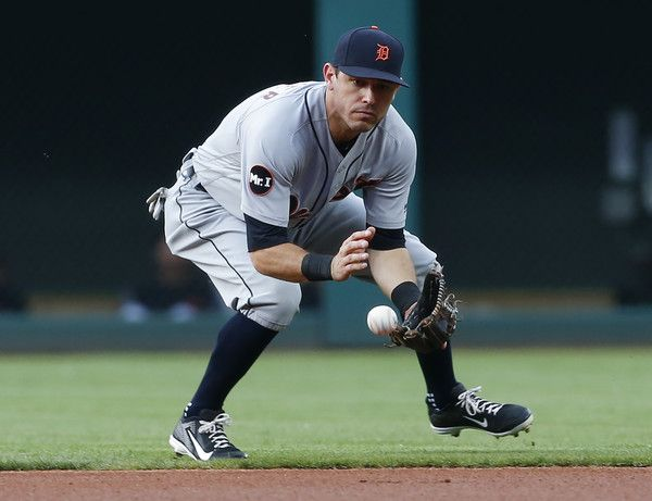 Ian Kinsler Photos Photos - Ian Kinsler #3 of the Detroit Tigers fields a ground ball before throwing out Francisco Lindor of the Cleveland Indians at first base during the first inning at Progressive Field on July 9, 2017 in Cleveland, Ohio. - Detroit Tigers v Cleveland Indians