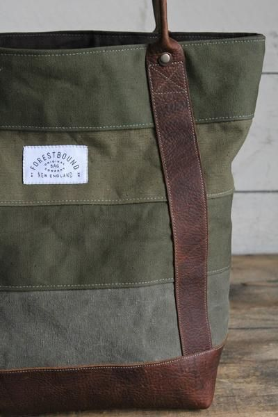Sturdy canvas in various shades of olive green all salvaged from WWII era US military duffel bags have been combined and reworked into a great every day carryal