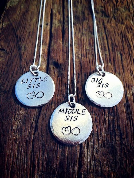 These necklaces are so adorable. There is one for each sister, big sister, middle sister and little sister. Hand stamped just as shown in the picture. . The pendant is 3/4 inch. This is a set of 3. Sterling silver. Comes on 18 inch sterling box chain. Great matching gifts for