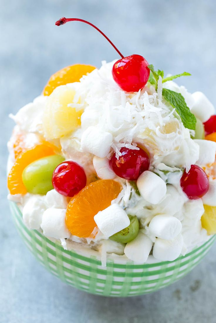 This recipe for ambrosia salad is a variety of colorful fruit with marshmallows and coconut, tossed in a light and creamy dressing.