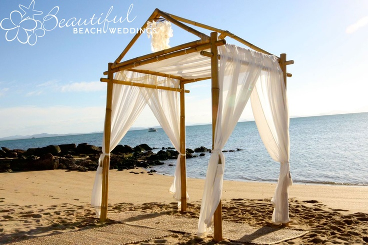 BLONDE BAMBOO ARBOUR WITH ROOF - Our beautiful blonde bamboo arbour looks great with the pitched roof as seen here. The draping still gives the bride and groom a little shade from the sun and hangings look great hung from the pitch at the top.