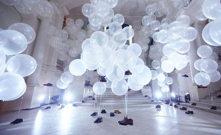 A/W 2015 / Berluti: Further adding to the magic of the evening presentation was an intallation of the house's iconic lace-ups floating in mid-air, courtesy of clusters of helium balloons