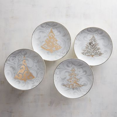 Our porcelain appetizer plate set features four tree designs, each with golden or silvery trim. Perfect for serving finger foods at holiday get-togethers, they're also a wonderful gift for a good friend who loves to host soirees.