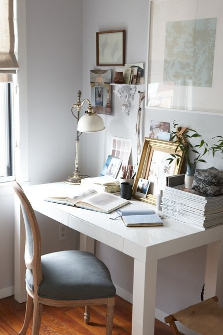 beautiful and eclectic workspace.  love the vintage louis chair, parsons desk, and grey walls.