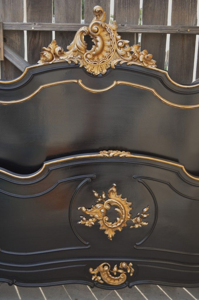 How to paint wood furniture with lacquer. Antique bed in a black lacquer finish with gold leaf accents.