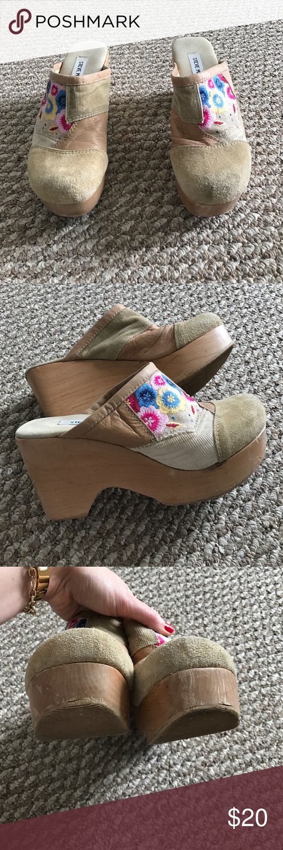 """Steve Madden Clogs Steve Madden Clogs. Suede mixed with corduroy plus an adorable flower design. Flowers include blues yellows and pinks. Clogs are overall in the tan family. The heel is 3.5"""" and the platform is approx 1.5"""". These Clogs gives off a very vintage / hippie feeling. There is wear to these Clogs as seen in the pictures but they are ready to be put on and worn! Overall they appear cute and fine! Smoke free home! Steve Madden Shoes Mules & Clogs"""