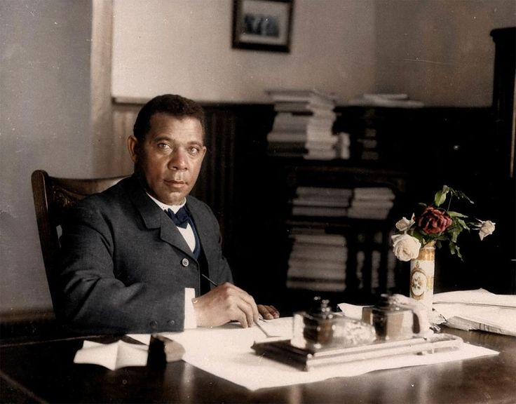 Colourised Booker T. Washington in his Tuskegee University office, 1906.