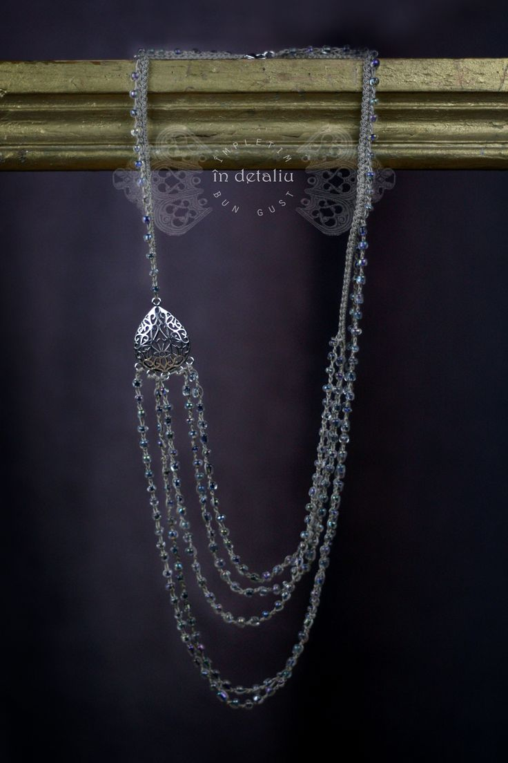 Crocheted necklace with semiprecious stones.