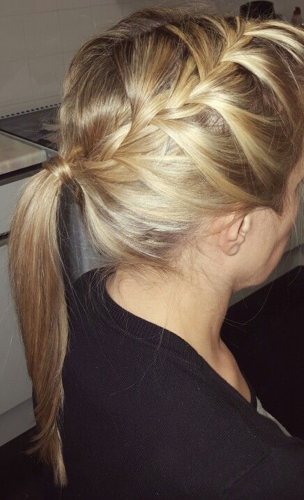 two loose french plaits into a ponytail