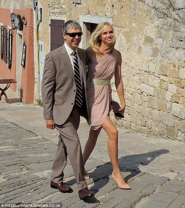 Romantic break: Larry Page and his wife Lucinda Southworth walk the cobbled streets of Motovun to his brother-in-law's wedding ceremony