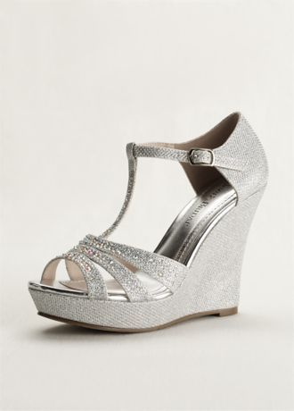 "**Bridesmaid Shoes** You will light up the night in these dazzling wedge sandals! Wedge T-strap sandal is embellished with glitter. Buckle closure. Available in Champagne and Silver. Heel height: 4 3/4"". Imported."