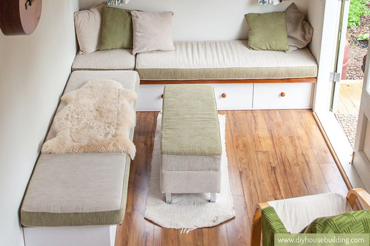 Who says a tiny house can't have a sectional? This set up seats 8 and could possibly sleep 2 overnight guests. I also love the french doors for light and openness.