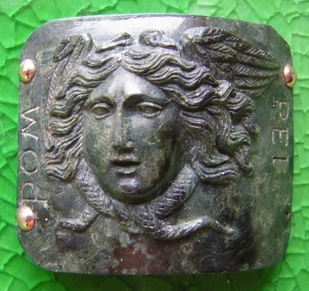 Medusa      Materials: hard-stone, gold  Date and origin: Italy, ca 1850-1880  Size: 1 1/2 by 1 3/8 inches  Condition: flawless.