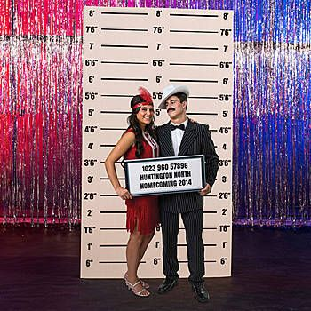 Our Mugshot Background has the look of an old mugshot board that includes the height measurement marks. This cardboard prop is printed on one side.