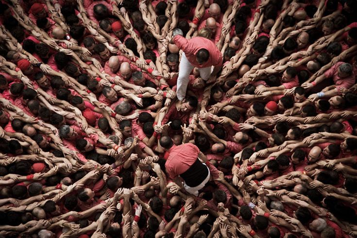 Concurs de Castells: human tower competition photographs by David Oliete | http://www.yellowtrace.com.au/pixel-people-incredible-images-formed-by-thousands-of-humans/ | Finding inspiration for interior design projects can be quite a challenge, so let yourself be inspired by beautiful shapes, colors and designs from many types of objects | www.bocadolobo.com #bocadolobo #luxuryfurniture #exclusivedesign #interiodesign #designideas #interiordesigners #projects #interiors #designprojects…
