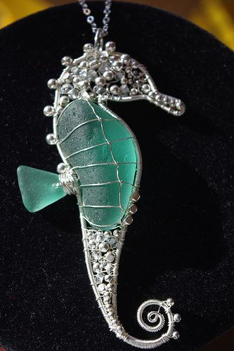 Wire wrapped sea glass and silver beads seahorse pendant...