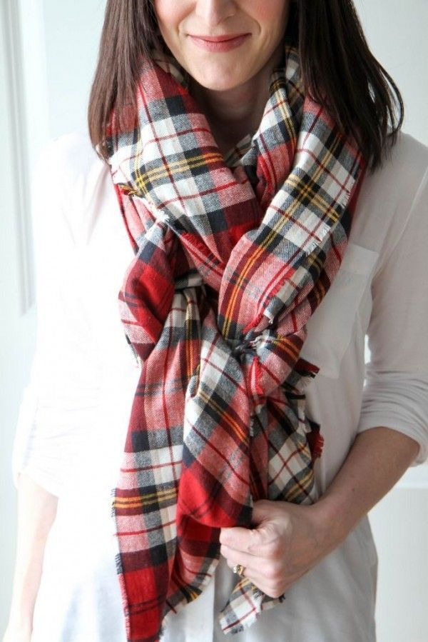 If you have too much fabric left over after looping it around your neck like you would a normal sized scarf, just tie the ends like so.