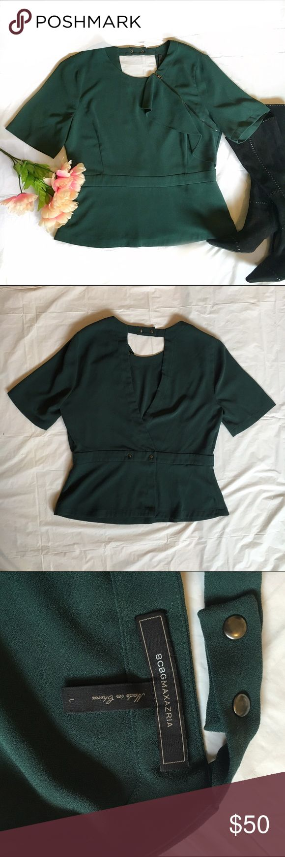 BCBG Max Azria peplum blouse Beautiful forest green peplum top. Features cascading ruffle detail and sipped shoulder. Open triangle in the back. This blouse is professional chic. BCBGMaxAzria Tops Blouses