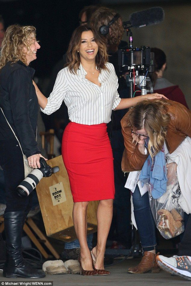 Helping hand: Eva Longoria was seen slipping into a pair of stilettos, with some help from...