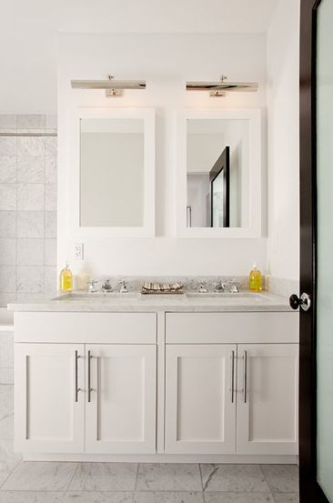 The Brooklyn Home Co.    It is possible to have double sinks in a small master bathroom. Creamy white white Restoration Hardware Hutton Medicine Cabinets, polished nickel picture lights
