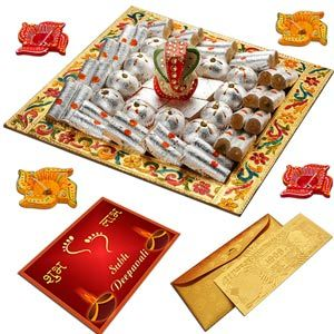 Haldiram's Ganesha Blessings  Send your joyous Diwali wishes in the most festive way with this special exotic mithai tray.  Costs Rs 2234/-  http://www.tajonline.com/diwali-gifts/product/d4432/haldirams-ganesha-blessings-diwali-hamper/?Aff=pinterest2013/