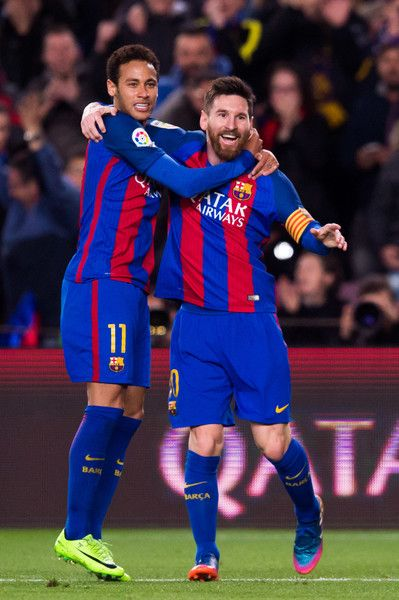 Lionel Messi (R) of FC Barcelona celebrates with his teammate Neymar Santos Jr (L) after scoring the opening goal during the La Liga match between FC Barcelona and RC Celta de Vigo at Camp Nou stadium on March 4, 2017 in Barcelona, Catalonia.