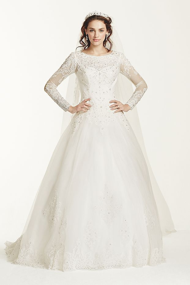 Don\'t be fooled: There\'s nothing demure about this tulle drop-waist ball gown with an illusion boatneck and long sleeves. In fact, it\'s downright bold to pick such a timeless and sophisticated wedd