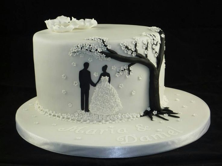I like the idea of the silhouette under the tree and how simple the cake is overall