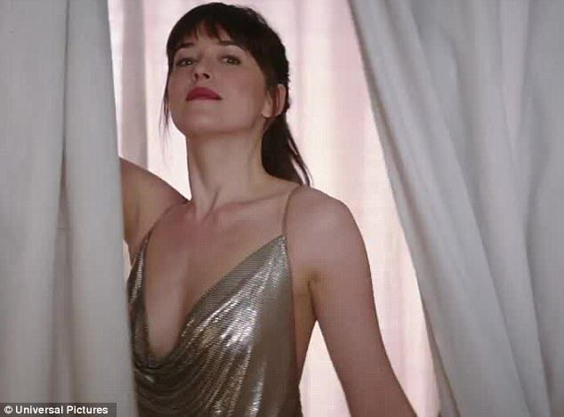 Stunner: The trailer shows anastasia in a stunning silver dress