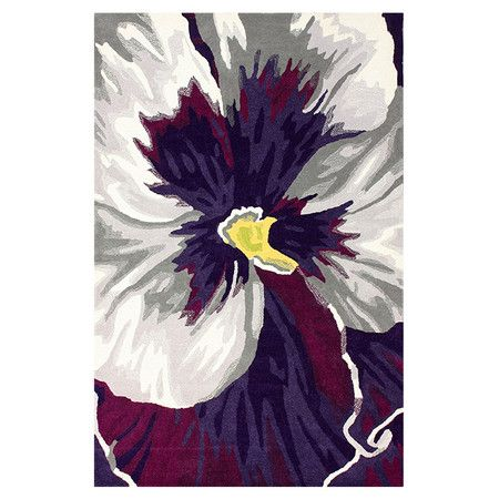Bring colorful appeal to your den or define areas in the living room with this hand-carved wool rug, showcasing a pansy motif.    ...