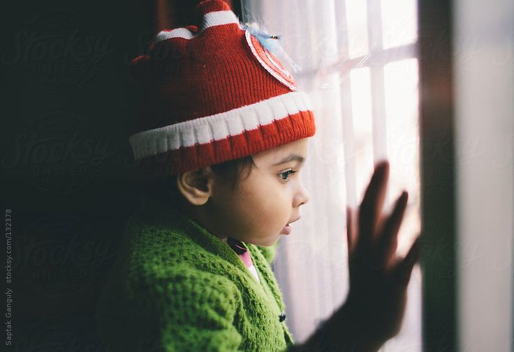 Toddler looking out the window by Saptak Ganguly