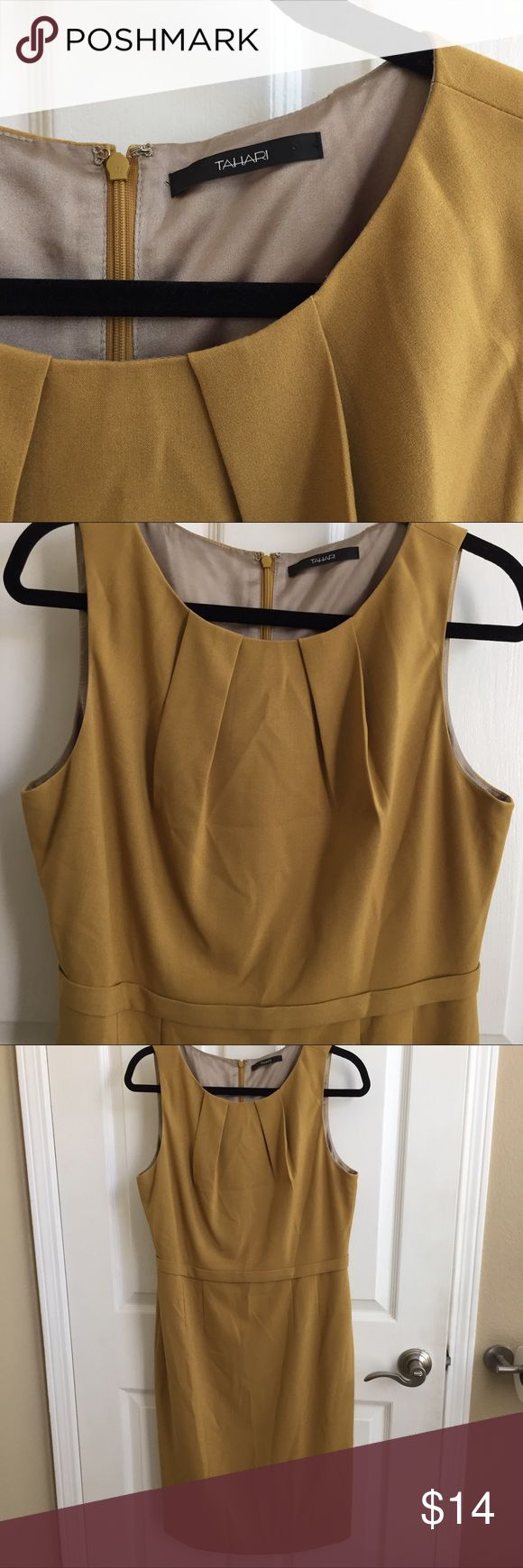 """Golden yellow Tahari dress Beautiful, fully lined career or special occasion dress in an elegant goldenrod /mustard color.  Can be used for the office or as a cocktail dress. Tailored details throughout, a hidden zipper closure and a self-belted waist make this dress ultra figure flattering. 39.5"""" from shoulder to hem. Chest measures 20"""" across (armpit to arm pit). Waist measures 17"""" across. Tahari Dresses Midi"""