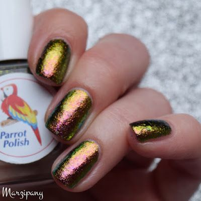 """parrot polish """"synergy"""" - transparent base filled w/ multichrome flakes ranging from green, gold, copper, orange, red & pink 
