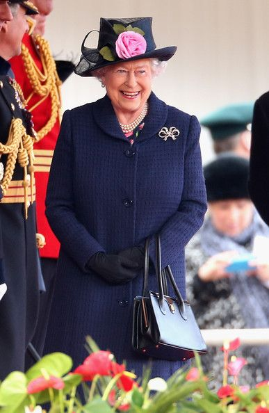 Queen Elizabeth II looks on as she welcomes the President of Singapore Tony Tan Keng Yam (not seen) at Horseguards on October 21, 2014