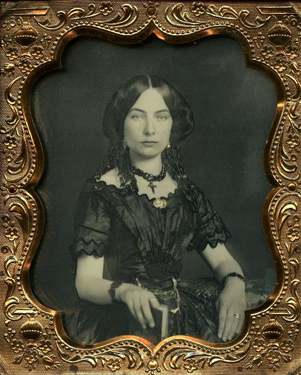 Victorian lady in a very gothic feel black lace, holding a book. Photo has an American feel, though I'm not sure, it may not be. #vintage #girlgotstyle #hauntingbeauty