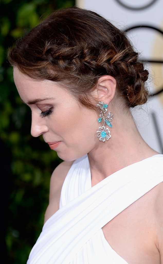 Emily Blunt from Best Beauty Looks at the 2015 Golden Globes  Leave it to the Into the Woods actress to add a little boho vibe to her look in the form of a braided updo. Bridesmaids-to-be, take note.