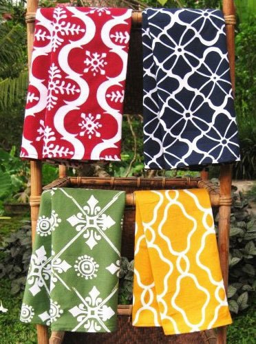 batik textiles inspired by Indian and Balinese prints-- great idea to hang textiles from rustic ladders