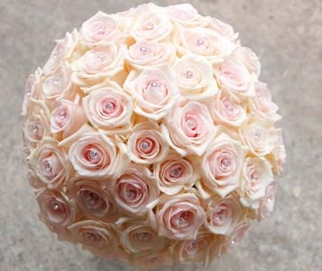 GORGEOUS compact posy of 'Audio' roses with crystal detailing.